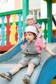 Two children on slide — Stock Photo