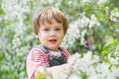 Baby girl in spring — Stock Photo
