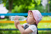 Two-year child drinks from bottle — Stock Photo