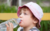 Child drinking from bottle — Stock Photo