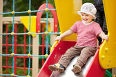 Happy two-year child on slide — Stock Photo