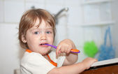 Baby gir brushes her teeth — Stock Photo