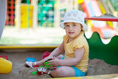 Two-year child playing in sandbox — Stock Photo