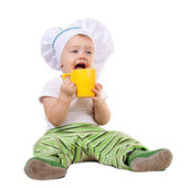 Baby cook in toque with cup — Stock Photo