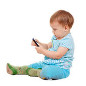 Toddler using mobile phone — Stock Photo