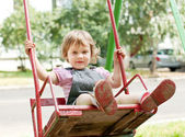 Baby girl on swing — Stock Photo