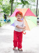 Two-year baby girl with umbrella — Stock Photo