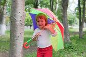 Baby girl with umbrella — Stock Photo