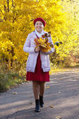 Mature woman in autumn with maple posy — Stock Photo