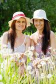 Women in dandelion plant — Stock Photo