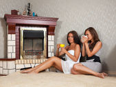 Women near the fireplace — Stok fotoğraf