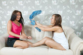 Happy girls playing with clothes — Stock Photo