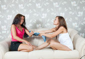 Happy women fighting with clothes — Stock Photo