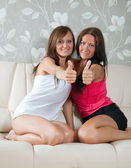 Women showing thumb up — Stock Photo