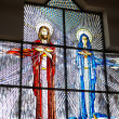 Stained glass with Jesus and Mary - Stock Photo