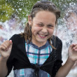 The girl in a fountain — Stock Photo