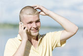 Guy talks on a mobile phone — Stock Photo