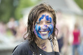 Portrait of the cheerful dirty girl — Stockfoto