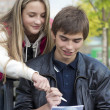 Stock Photo: The girl and the young man write in a notebook