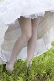Female feet under a crinoline — Stock Photo