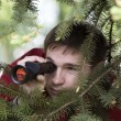 Man looking in binoculars — Stock Photo