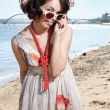 The lovely girl looks over sun glasses — Stock Photo #11252176