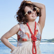 The beautiful girl in sun glasses — Stock Photo