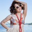 The beautiful girl in sun glasses — Stock Photo #11252208