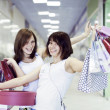Two girlfriends with shopping bags - Foto Stock