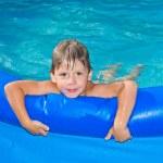 Boy in the swimming pool — Stock Photo