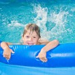 Boy in the swimming pool — Stock Photo #11731653