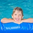 Boy in the swimming pool — Stock Photo