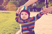 Child wal in sunny park — Stock Photo