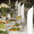 Wedding tables covered with refreshments — Stock Photo