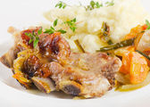Veal ribs with mashed potato and vegetables — Stock Photo