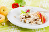 Healthy breakfast - muesli and fruits — Stock Photo