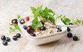 Healthy breakfast - muesli and berry — Stock Photo