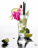 Young smiling woman in mojito glass — Stock Photo