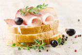 Sandwich on a wooden table — Stock Photo