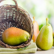 Fresh pears in the basket — Stock Photo