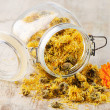 Calendula - medicinal herbs on wooden table — Stock Photo #12156640