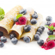 Pancakes with raspberries and blueberries isolated on white — Stock Photo