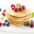 Pancakes with raspberries and blueberries isolated on white — Stock Photo #12333472