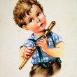 Stock Photo: Boy playing pipe