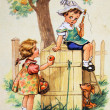 Girl holds out an apple to the boy, who sits on the dog house — Stock Photo #11865846