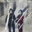 Boys with brooms and ladders against the background of the stree — Stock Photo
