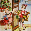 SWEDEN - CIRC1959: Greeting Christmas postcard printed in Sweden shows boy and girl with gifts, circ1959 — Stock Photo #11867799