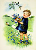 Boy with wild flower — Stock Photo
