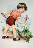 Boy with a spade in the garden — Stock Photo