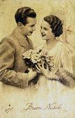 Happy couple with flowers — Stock Photo